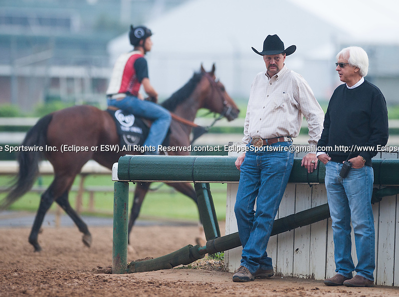 Kentucky Derby winning trainers Chip Woolley and Bob Baffert talk during morning workouts at Churchill Downs in Louisville, Kentucky on May 1, 2012.
