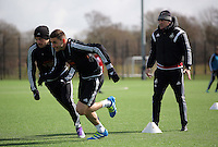 L-R Players Gylfi Sigurdsson and Angel Rangel with head coach Francesco Guidolin during the Swansea City FC training at Fairwood training ground in Wales, UK on Wednesday 06 April 2016