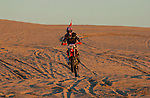 Dirt bike on dunes