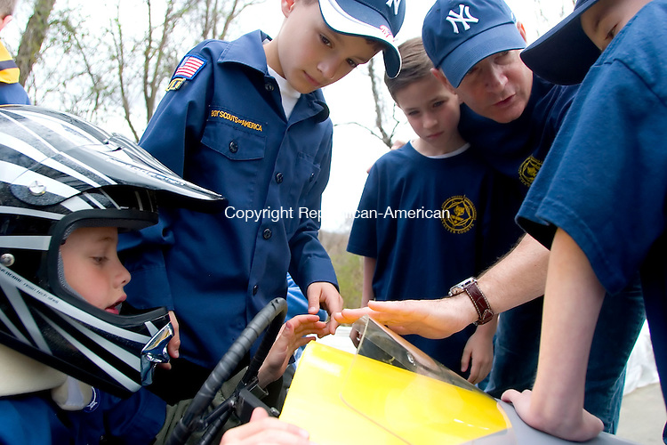 BETHLEHEM, CT- 29 APRIL 07- 042907JT09-<br /> From left, Riley Steiner, Zachary Duda, and Jack and John Palumbo check out one of the five soap box cars built by Cub Scout Pack 459 before their 2nd annual Downhill Derby on Hard Hill Road North in Bethlehem on Sunday.<br /> Josalee Thrift Republican-American