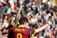Calcio, Serie A: Roma vs Napoli. Roma, stadio Olimpico, 25 aprile 2016.<br /> Roma&rsquo;s Radja Nainggolan, left, celebrates with teammates Diego Perotti, center, and Miralem Pjanic, after scoring the winning goal during the Italian Serie A football match between Roma and Napoli at Rome's Olympic stadium, 25 April 2016. Roma won 1-0.<br /> UPDATE IMAGES PRESS/Riccardo De Luca