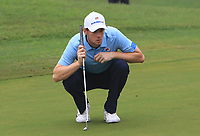 Thomas Pieters (Europe) on the 5th green during the Saturday Foursomes of the Eurasia Cup at Glenmarie Golf and Country Club on the 13th January 2018.<br /> Picture:  Thos Caffrey / www.golffile.ie