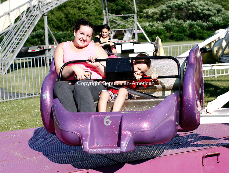 Washington, CT- 05 Jul7 2014-070514CM06-  Brittany Wilson, left, and Sean LaCasse, 5, of Torrington ride The Sizzler during the Town of Torrington's annual 4th of July carnival and fireworks celebration at Torrington Middle School on Saturday.    Christopher Massa Republican-American