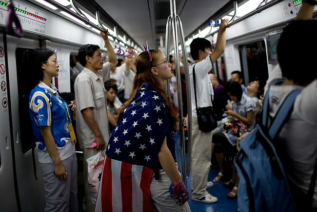 Megan Sisson, 23, of Tampa, Florida, shows her support for the American Olympic gymnastics team while riding the subway in Beijing, China on Wednesday, August 13, 2008.  Kevin German