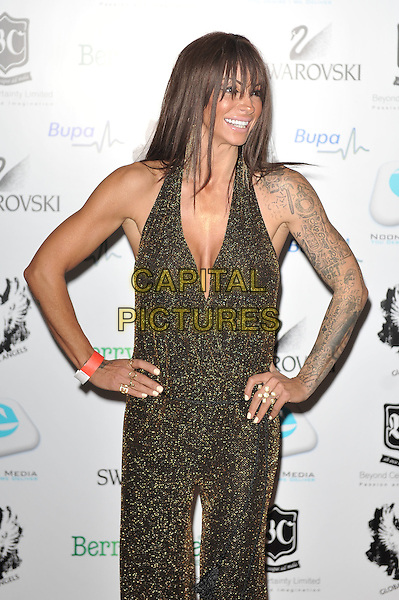 Jodie Marsh.'Global Angels Awards', The Park Plaza Hotel, Westminster, London, England. 2nd December 2011..half length gold sparkly catsuit jumpsuit halterneck tattoos hands on hips smiling.CAP/MAR.© Martin Harris/Capital Pictures.