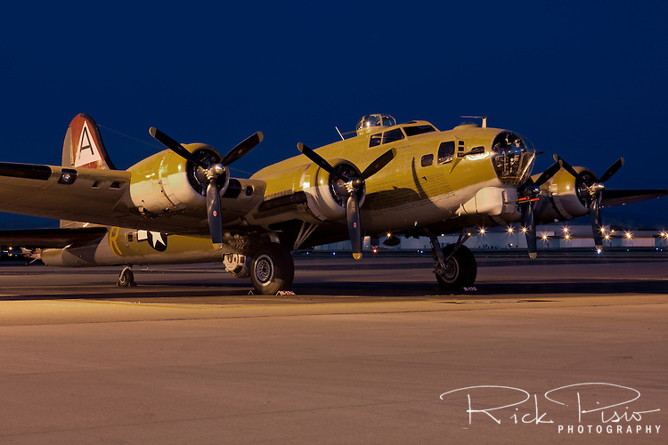 "Boeing built B-17 Flying Fortress ""Nine-O-Nine"" operated by the Collings Foundation sits on the ramp at Livermore Airport in Livermore, California, during its annual tour in May 2009. The Collings Foundation B-17 was named ""Nine-O-Nine"" in honor of a 91st Bomb Group, 323rd Squadron plane of the same name which completed 140 missions without an abort or loss of a crewman. The original ""Nine-O-Nine"" was assigned to combat on February 25, 1944. By April 1945, she had made eighteen trips to Berlin, dropped 562,000 pounds of bombs, and flown 1,129 hours. She had twenty-one engine changes, four wing panel changes, fifteen main gas tank changes, and 18 Tokyo tank changes (long-range fuel tanks). She also suffered from considerable flak damage."