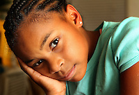 Taunton, MA  --  Dajanae Turner, 9, adopted daughter of Anthony Glover who was murdered in 2009, waits for his murder to be solved.  His case is one of many cold cases thanks to what police say is a code of silence.  Tuesday, November 8, 2011.
