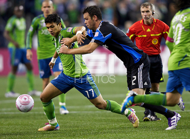 Seattle Sounders FC forward Fredy Montero, left, escapes the grasp San Jose Earthquakes defender Bobby Burling during play at CenturyLink Field in Seattle Saturday October 15, 2011. The Sounders FC won the game 2-1.