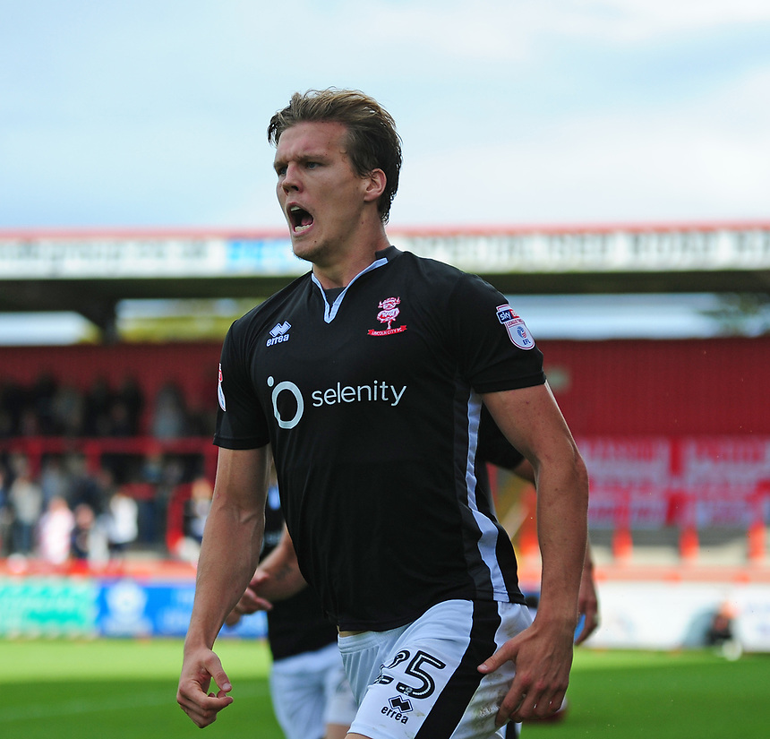 Lincoln City's Sean Raggett celebrates scoring his sides first goal<br /> <br /> Photographer Andrew Vaughan/CameraSport<br /> <br /> The EFL Sky Bet League Two - Stevenage v Lincoln City - Saturday 9th September 2017 - The Lamex Stadium - Stevenage<br /> <br /> World Copyright &copy; 2017 CameraSport. All rights reserved. 43 Linden Ave. Countesthorpe. Leicester. England. LE8 5PG - Tel: +44 (0) 116 277 4147 - admin@camerasport.com - www.camerasport.com