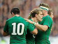 15th March 2014; Andrew Trimble, Ireland, celebrates with team mates, Jonathan Sexton and Jamie Heaslip after scoring a try. RBS Six Nations, France v Ireland, Stade de France, St Denis, Paris. Picture credit: Tommy Grealy/actionshots.ie.