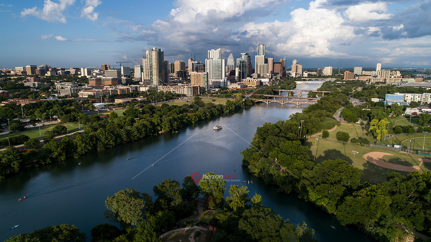 Beautiful aerial view of the downtown bustling downtown Austin Skyline overlooking Lady Bird Lake and the bridges connecting north and south side of town.