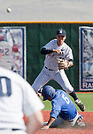 March 10, 2012:   Nevada Wolf Pack shortstop Kyle Hunt turns a double play against UC Santa Barbara Gauchos as Joe Woodward slides into second during  their NCAA baseball game played at Peccole Park on Saturday afternoon in Reno, Nevada.