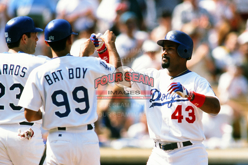 Raul Mondesi #43 of the Los Angeles Dodgers during a game at Dodger Stadium circa 1999 in Los Angeles, California. (Larry Goren/Four Seam Images)