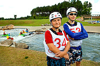 Young outdoor enthusiasts learn the art of whitewater kayaking during a summer camp session at the US National Whitewater Center (USNWC) in Charlotte NC. The USNWC is home to one of the world's largest manmade recirculating whitewater courses. Two boys in this photo are model released.