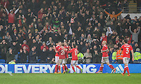 Simon Church of Wales is mobbed after scoring his side's equalising goal from the penalty spot during the International Friendly match between Wales and Northern Ireland at Cardiff City Stadium, Cardiff, Wales on 24 March 2016. Photo by Mark  Hawkins / PRiME Media Images.