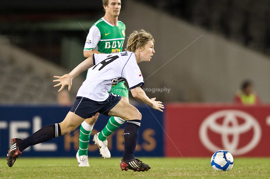 MELBOURNE, AUSTRALIA - APRIL 14: Luke Pilkington (24) of Melbourne Victory runs with the ball during the AFC Asian Champions League Group E match between the Melbourne Victory and Beijing Guoan at Etihad Stadium on April 14, 2010 in Melbourne, Australia. Mandatory Credit: Sydney Low / Southcreek Global