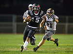 Lawndale, CA 09/29/17 - Jalen Hamler (Lawndale #15) and Brian Downie (Torrance #21) in action during the Torrance vs Lawndale CIF Varsity football game at Lawndale High School.   Lawndale defeated Torrance 42-0.