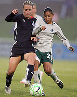 Lori Lindsey #6 of the Washington Freedom shoulders into Francielle #21 of St. Louis Athletica during a WPS match at the Maryland Soccerplex on May 3, 2009 in Boyds Maryland. The game ended in a 3-3 tie.