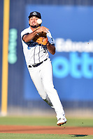 Asheville Tourists shortstop Coco Montes (5) throws to first base during a game against the Lakewood BlueClaws at McCormick Field on August 5, 2019 in Asheville, North Carolina. The BlueClaws defeated the Tourists 4-2. (Tony Farlow/Four Seam Images)