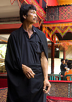 man  at a traditional funeral in a village in Toraja land, Sulawesi, Indonesia
