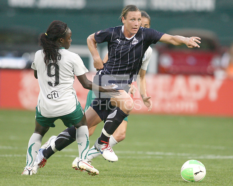 Abby Wambach #20 of the Washington Freedom races away from Eniola Aluko #9 of St. Louis Athletica during a WPS match on May 1 2010, at RFK Stadium, in Washington D.C. Freedom won 3-1.