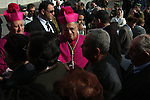 The head of the Roman Catholic Church in the Holy Land, the Latin Patriarch of Jerusalem Fuad Twal stops next to the separation wall between the West Bank town of Bethlehem and Jerusalem on his way to the Church of Nativity on 24 December 2009. Twal, a 69-year-old Jordanian who was appointed Latin Patriarch last year, is to lead the Midnight Mass at Bethlehem's early medieval Church of the Nativity, built according to Christian tradition on the site of the stable where Jesus was born. Photo by Issam Rimawi