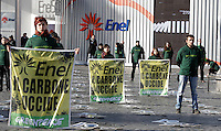 "Attivisti di Greenpeace inscenano un'azione di protesta in occasione delle celebrazioni per il 50esimo anniversario della fondazione dell'ENEL, in piazza del Popolo, Roma, 6 dicembre 2012. Secondo uno studio dell'istituto indipendente olandese SOMO, le emissioni delle centrali a carbone dell'ENEL causerebbero 366 morti premature l'anno..Greenpeace activists hold flags reading ""ENEL, coal kills"" during a protest in occasion of a happening marking the 50th anniversary of the Italian ENEL power company foundation, in downtown Rome, 6 December 2012. According to a research made by the Independent institute SOMO, of the Netherlands, ENEL's coal power plants emissions would cause 366 premature deaths every year in Italy. .UPDATE IMAGES PRESS/Riccardo De Luca"