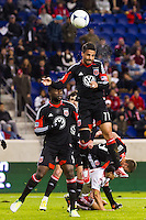 Marcelo Saragosa (11) of D. C. United heads the ball. D. C. United defeated the New York Red Bulls 1-0 (2-1 in aggregate) during the second leg of the MLS Eastern Conference Semifinals at Red Bull Arena in Harrison, NJ, on November 8, 2012.