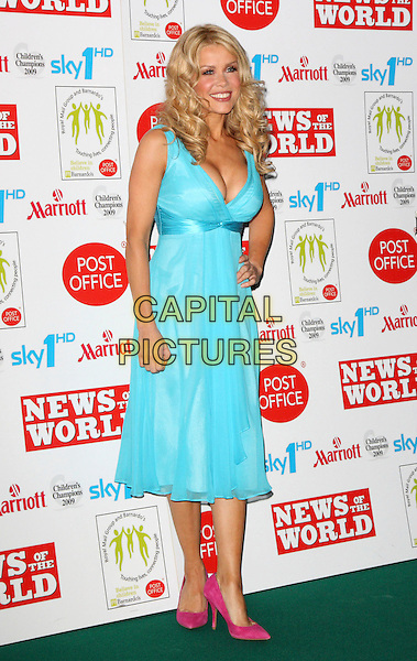 MELINDA MESSENGER .Children's Champions Awards 2009 at the Grosvenor House Hotel, Park Lane, London, England, March 4th 2009..full length blue turquoise dress cleavage pink shoes hand on hip pointy suede .CAP/ROS.©Steve Ross/Capital Pictures