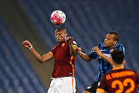 Calcio, Serie A: Roma vs Inter. Roma, stadio Olimpico, 19 marzo 2016.<br /> Roma's Seydou Keita, left, and FC Inter's Jonathan Biabiany jump for the ball during the Italian Serie A football match between Roma and FC Inter at Rome's Olympic stadium, 19 March 2016. The game ended 1-1.<br /> UPDATE IMAGES PRESS/Riccardo De Luca