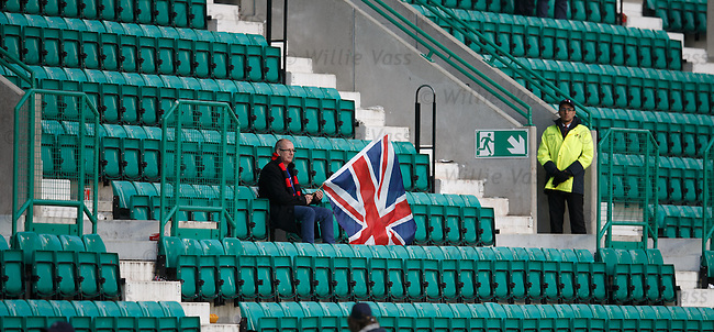 A lone Rangers fan sits dejectd at the end