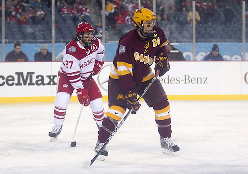 February 17, 2013:  Minnesota forward Zach Budish (24) and Wisconsin defenseman Frankie Simonelli (27) during NCAA Hockey game action between the Minnesota Golden Gophers and the Wisconsin Badgers at Soldier Field in Chicago, Illinois.  Wisconsin defeated Minnesota 3-2.