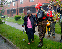 A rescue team from the North Carolina National Guard 1/120th battalion evacuates an elderly woman from her apartment as the rising floodwaters from Hurricane Florence threatens her home in New Bern, N.C., on Friday, Sept. 14, 2018. (AP Photo/Chris Seward)