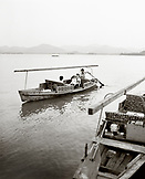 CHINA, Hangzhou, family taking a tour in a boat on West Lake (B&W)