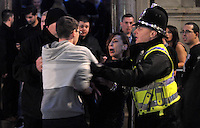 Pictured: A policeman breaks off people fighting in the early hours of New Year's Day. Sunday 01 January 2017<br /> Re: Revellers out celebrating the New Year in the pub and club on Wind Street Swansea