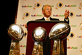 Joe Gibbs meets press after being named head coach of the Washington Redskins at Redskin Park in Ashburn, Virginia on January 8, 2004.  Gibbs previously worked as  the head coach of the Redskins from 1981 through 1992 and won the three Lombardi Trophies pictured in front of him.<br /> Credit: Arnie Sachs / CNP