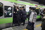 March 17, 2011, Tokyo, Japan - Commuters at Yurakucho Station in Tokyo attempt to make it home before the possible power outage planned in an attempt to conserve electricity. The power grid has been impacted heavily by the recent earthquake and its aftermath. (Photo by AFLO) [0006]..