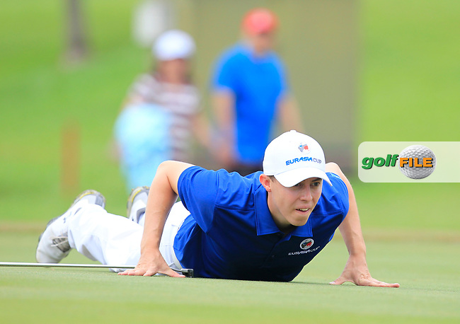Matthew Fitzpatrick (Europe) on the 1st green during the Singles Matches of the Eurasia Cup at Glenmarie Golf and Country Club on the Sunday 14th January 2018.<br /> Picture:  Thos Caffrey / www.golffile.ie