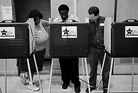 Chicago, Illinois, November 4th 2008.A voter gets help to cast his vote, when that happens, official representatives from both major parties need to be present. On Election Day, more than 140 million Americans went out to vote in this historic occasion.