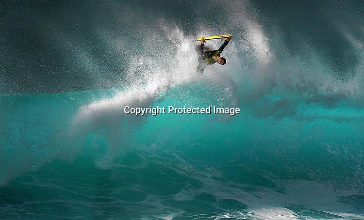 On boogie boarder at Ehukai Beach (Banzai Pipeline) on the Northshore of Oahu, Hawaii found the winter waves the perfect activity for President Day weekend.