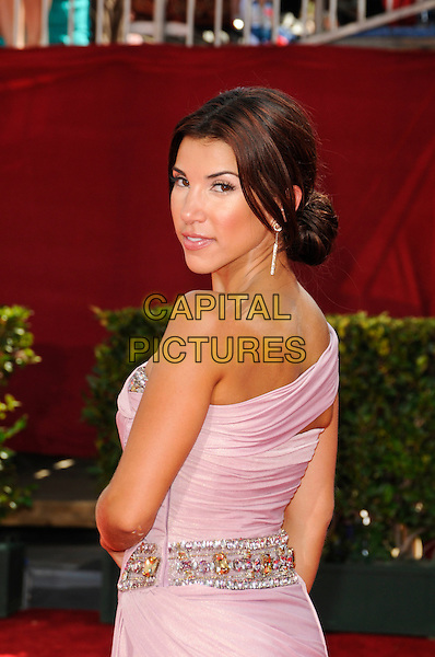 ADRIANNA COSTA .arriving at the 61st Annual Primetime Emmy Awards at the Nokia Theatre in Los Angeles, California, USA,.September 20th, 2009.  .emmys arrivals half length pink dress draped gown one off the shoulder strapess hand on hip looking back over shoulder rear behind .CAP/ROT.©Lee Roth/Capital Pictures