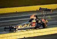 Sept. 21, 2012; Ennis, TX, USA: NHRA top fuel dragster driver Terry McMillen during qualifying for the Fall Nationals at the Texas Motorplex. Mandatory Credit: Mark J. Rebilas-US PRESSWIRE