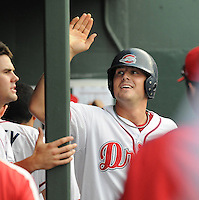 August 13, 2009: Ryan Lavarnway (33) of the Greenville Drive is congratulated in the dugout after scoring a run in a game against the Greensboro Grasshoppers at Fluor Field at the West End in Greenville, S.C. Photo by: Tom Priddy/Four Seam Images