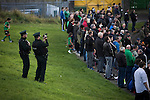 Glentoran 2 Cliftonville 1, 22/10/2016. The Oval, NIFL Premiership. A police officer videoing a section of the home support as they watch the first-half action at The Oval, Belfast as Glentoran hosted city-rivals Cliftonville in an NIFL Premiership match. Glentoran, formed in 1892, have been based at The Oval since their formation and are historically one of Northern Ireland's 'big two' football clubs. They had an unprecendentally bad start to the 2016-17 league campaign, but came from behind to win this fixture 2-1, watched by a crowd of 1872. Photo by Colin McPherson.