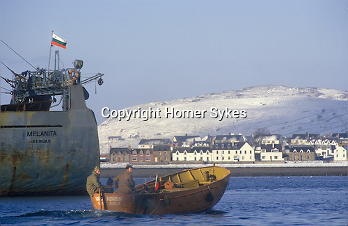 Ullapool Scotland. 1986. Loch Broom. A Bulgarian factory fishing boat, men going on shore leave.