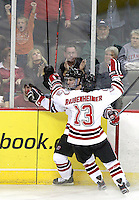 Nebraska-Omaha's Jayson Megna (11) celebrates his goal with Zahn Raubenheimer (13). Nebraska-Omaha defeated Colorado College 7-5 Friday night at CenturyLink Center in Omaha. (Photo by Michelle Bishop) .