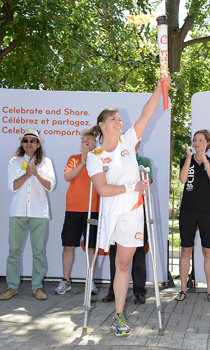 Toronto, ON - Aug 7 2015 - Toronto 2015 Assistant Chef de Mission Stephanie Dixon participates in the torch relay for the Toronto 2015 Parapan American Games  (Photo: Matthew Murnaghan/Canadian Paralympic Committee)