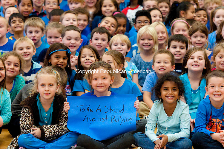 NAUGATUCK, CT-101614JS02- Leah Chapman, a kindergartner at Western school hold a sang as she and her fellow students and staff wore blue on Thursday in support of taking a stand against bullying. Along with wearing blue, each class had lessons related to bullying as well as donating a canned goods to benefit the Naugatuck Food Bank. <br />  Jim Shannon Republican-American