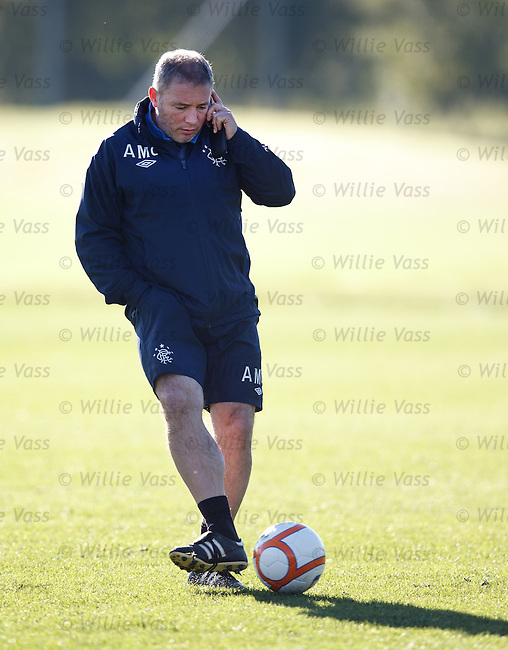 Ally McCoist puts in a call at training