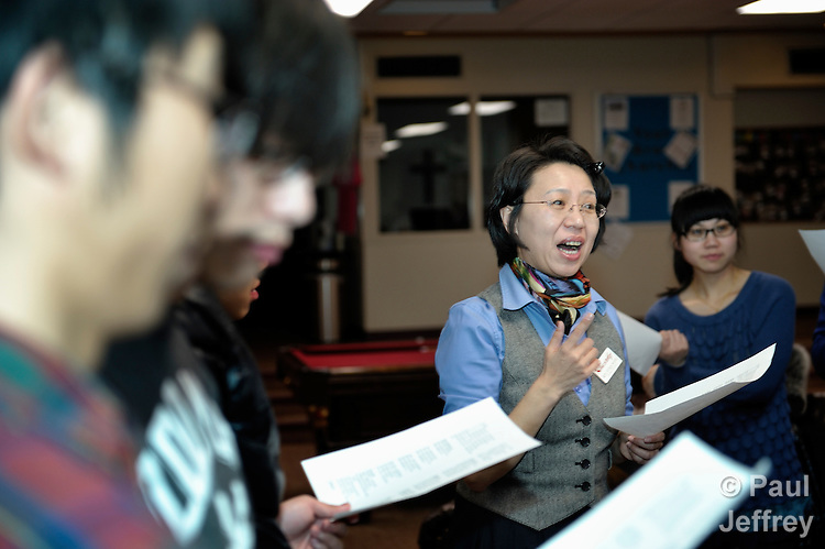 The Rev. Fuxia Wang (right) is a United Methodist missionary, serving as a church and community worker on the staff of the Wesley Center at the University of Oklahoma in Norman, where she works with international students. Here she leads singing with students who came to the Wesley Center for a celebration of Chinese New Year.